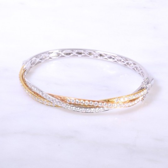 Diamond set intertwined gold bangle