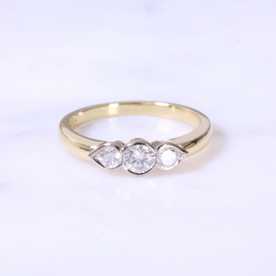 Rub-Over Round Brilliant 3 stone Ring with Pear Setting