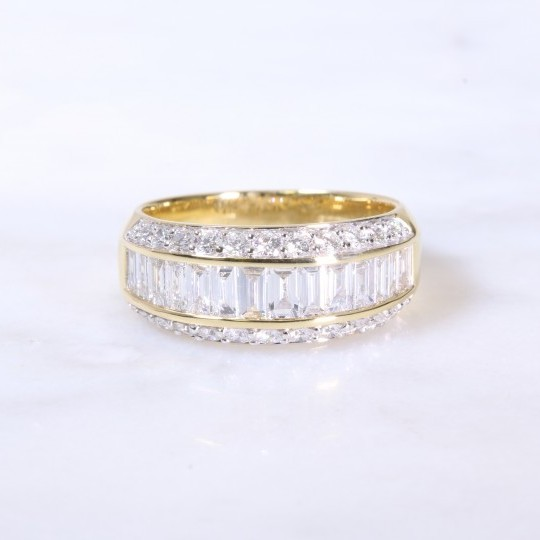 Round brilliant & baguette diamond channel set eternity ring