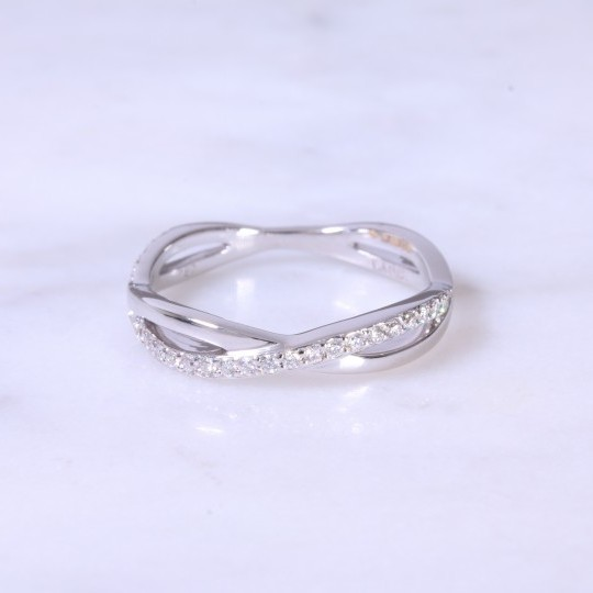 Intertwined diamond set eternity ring